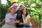 Toby at Christmas with his family and Mr. and Mrs. Claus